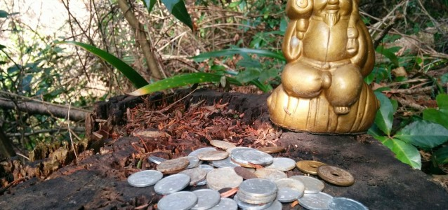 statue and coins